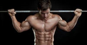 ripped guy lifting barbell over shoulder