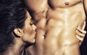 woman kissing man's abs