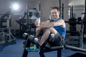 Mid adult man drinking his protein shake and taking rest after workout in the gym