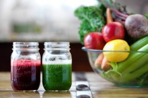 fresh fruit and vegetable juices in mason jar