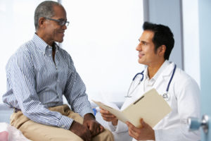 elderly man consulting with his doctor
