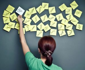 woman with post-it notes on wall