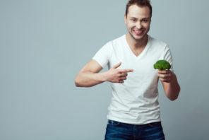man holding broccoli