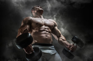 buff guy holding heavy dumbbells