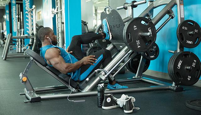 man doing leg press in gym