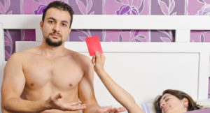 man receiving a red card from wife for sex