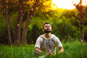 man meditating in the field
