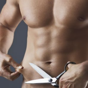 fit guy holding scissors mock cutting belly fat