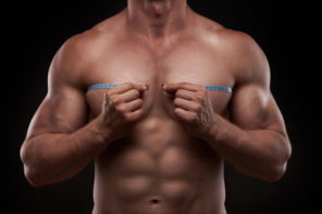 muscular guy measuring chest circumference