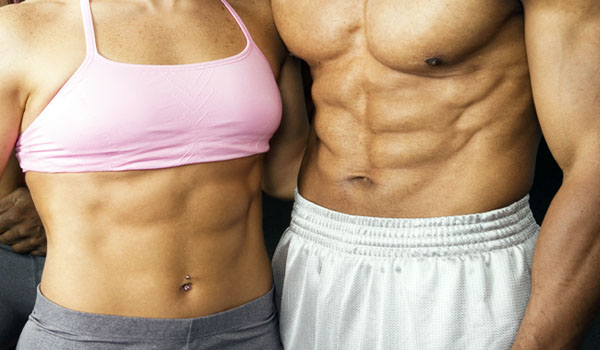 fit couple showing well defined abs