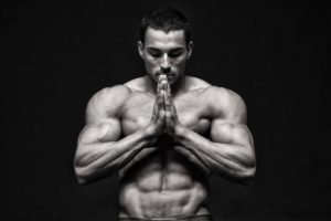 fit muscular guy with hands together black and white image