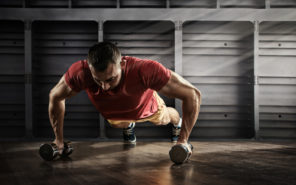 fit guy doing dumbbell push ups
