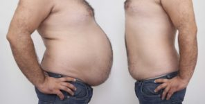 man with big belly and fitter man standing face to face weight loss