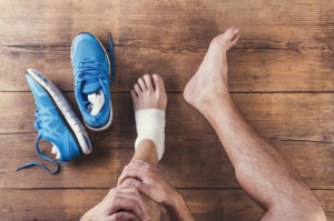 injured runner with sprained ankle