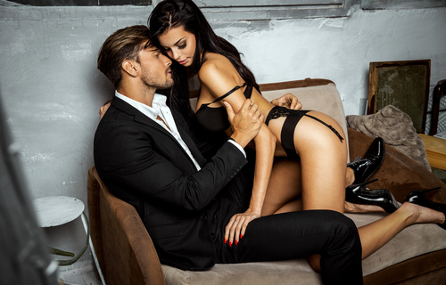 woman in lingerie seducing man in suit