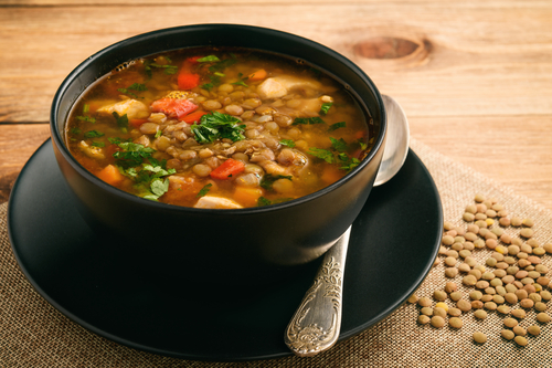 Hot soup with green lentil, chicken, vegetables and spices
