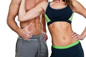 fit athletic couple with abs