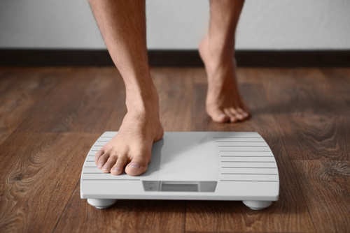 stepping on scale to check weight