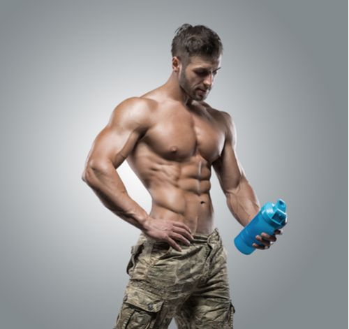 ripped guy holding water bottle