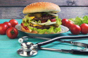 burger with stethoscope on table