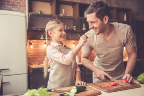 father and daughter preparing healthy vegetable meal