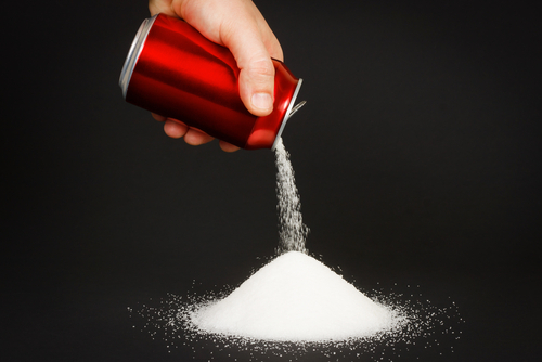 soda can pouring a lot of sugar