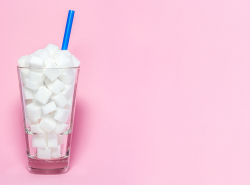 glass filled with sugar cubes