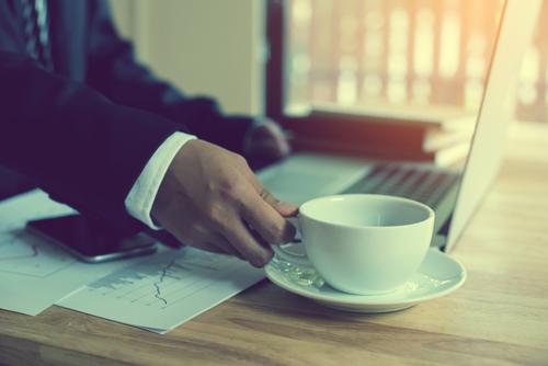 man drinking coffee during work