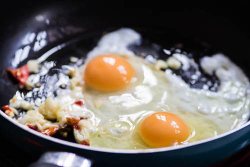 frying eggs on pan sunny side up