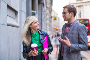 confident Progentra user chatting with woman on the street