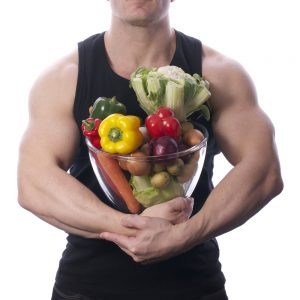 muscular guy taking Progentra carrying bowl full of vegetables