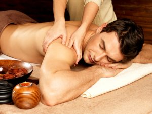 man relaxing with massage content with Progentra