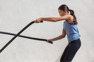 woman exercising with battle rope