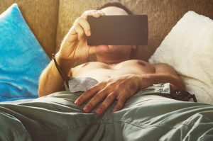 man watching porn on phone during masturbation