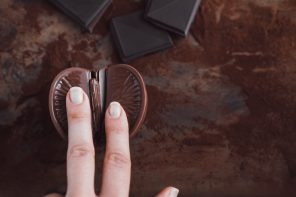 woman's finger on chocolate orange, vagina symbol