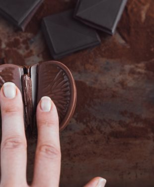 woman's finger on chocolate orange, vagina symbol