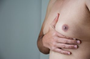 man holding enlarged breast should read about Progentra