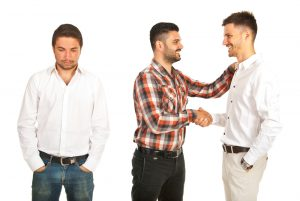 man with big ego jealous of 2 friends discussing Progentra