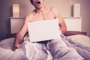 man with increased libido from Progentra masturbating in bed