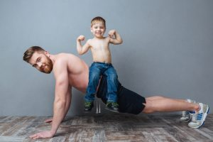 dad push up with son on his back is stronger with Progentra