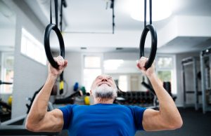 elder man working out in gym to help with Dementia prevention