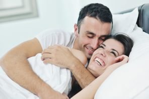 couple cuddling in bed in the morning and happy about Progentra