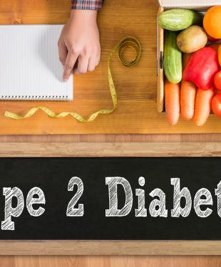 type 2 diabetes on chalk board with healthy fruits and vegetables