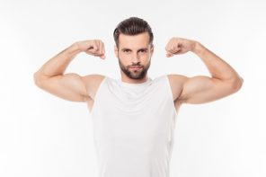 healthy man flexing his arms and has been using Progentra