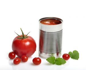 canned tomato next to fresh tomato