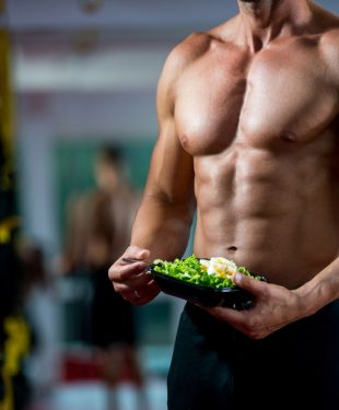 ripped guy eating salad
