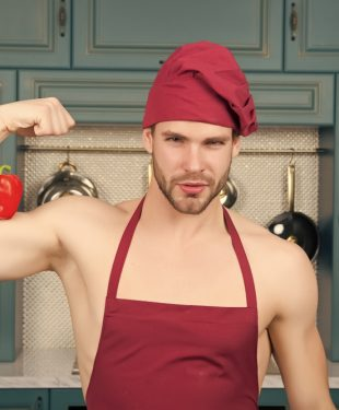 fit man cooking in kitchen