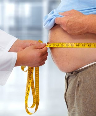obese man checked by doctor