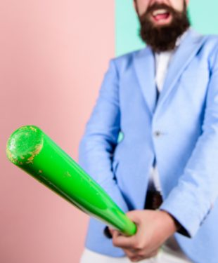 bearded man and a baseball bat