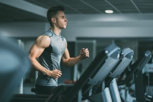 athletic man running on treadmill